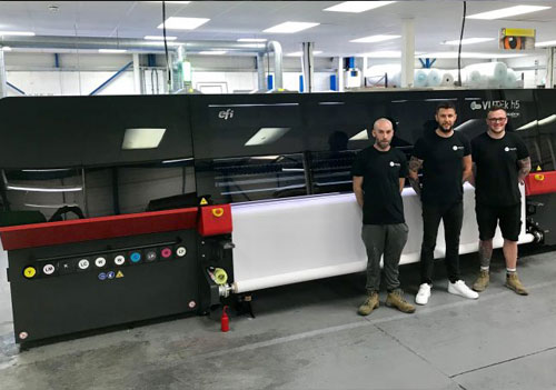 he IDL Colourlink team with their recently installed machine